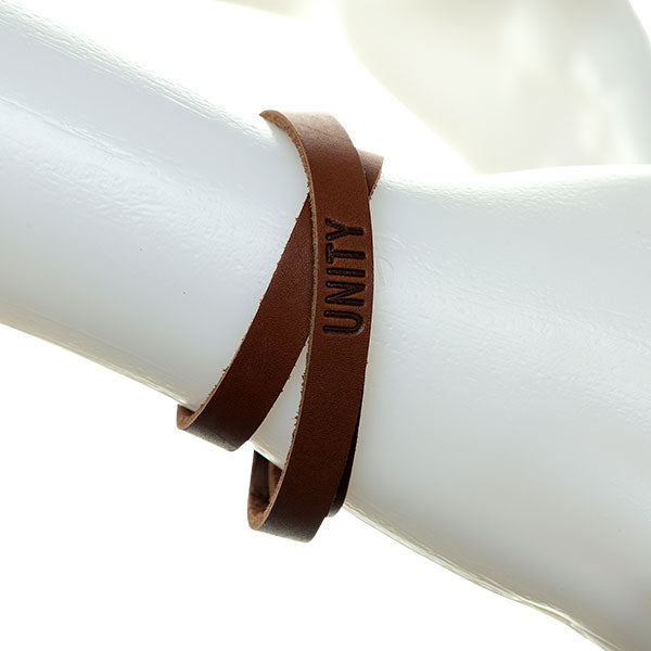Leather unity wrap bracelet on mannequin hand