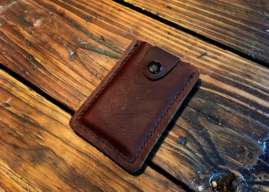 leather wallet on top of a wooden table