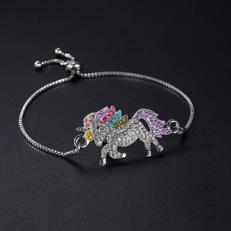Add a cute and sparkly touch to your outfit with this glamorous unicorn necklace, bracelet, and earrings. Makes a perfect gift for unicorn lovers!