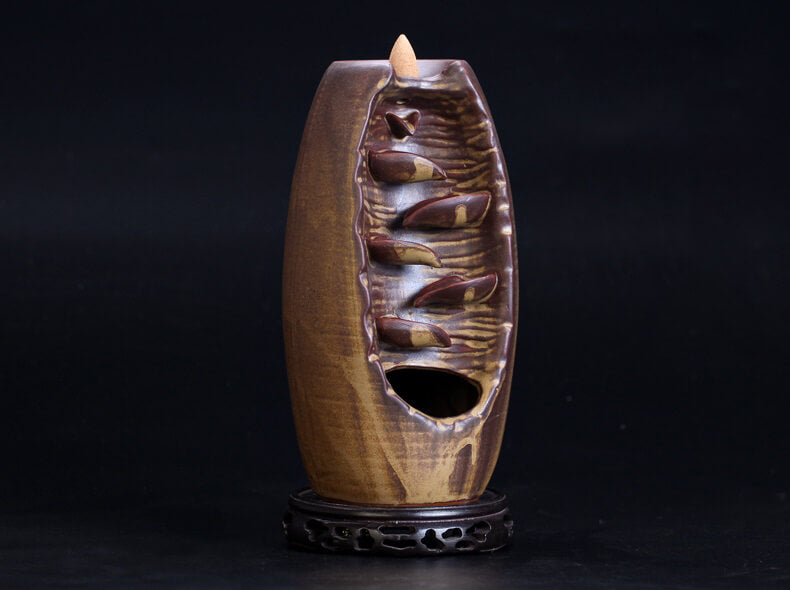 Our Koro™ Mountain River Handicraft Back-Flow Incense Burner has been carefully handcrafted of beautifully glazed ceramic. When the incense cone is lit, the trail of smoke mimics a waterfall flowing down a mountainside.