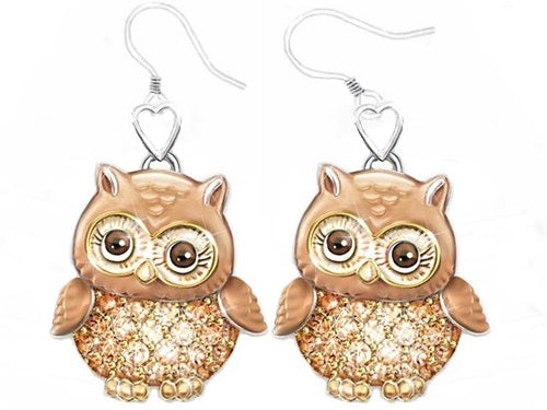 This lovely owl necklace is a real hoot and a wonderful way to express your love for your loved ones.  This adorable necklace features a hand-painted enameled owl with dazzling genuine crystals all over the owl's round belly.