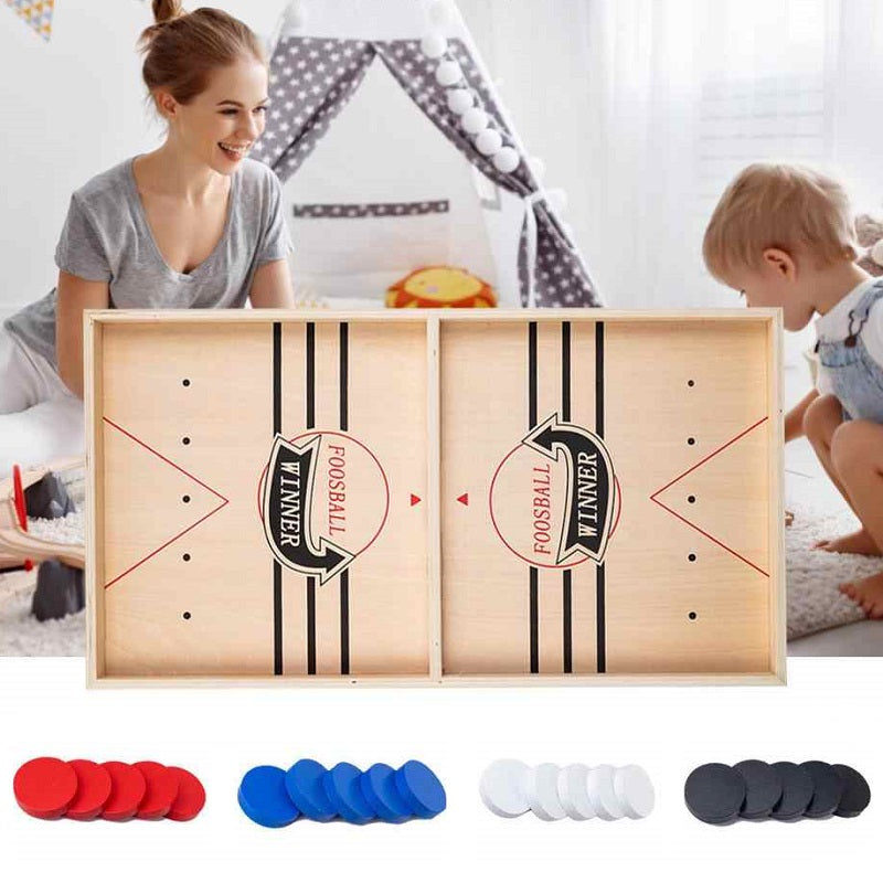 Tanoshi™ The Fast Sling Puck Board Game is a heart-pounding, action-packed game that has you racing your opponent to pass all the pucks through the center gate to the opposite side!