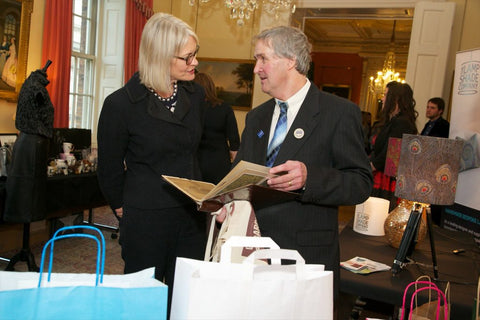 Paul speaking to the minster for small businesses after being 100 best small businesses