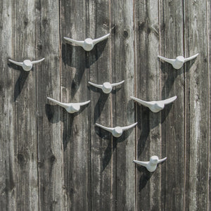 Flock of birds made of ceramic in astral white to easily adjust your home and house