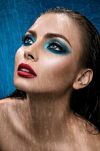 Downloadable Beauty Salon Photo - Woman in Bright Blue Eyeshadow in the Rain