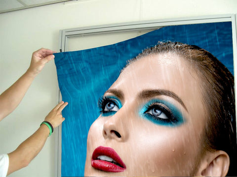 Aluminum Frames and Cloth - Woman in Bright Blue Eyeshadow in the Rain