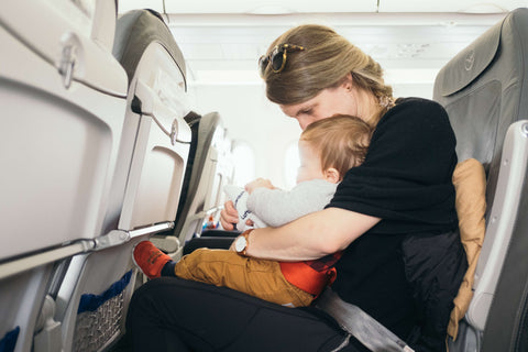 Baby and mom on airplane