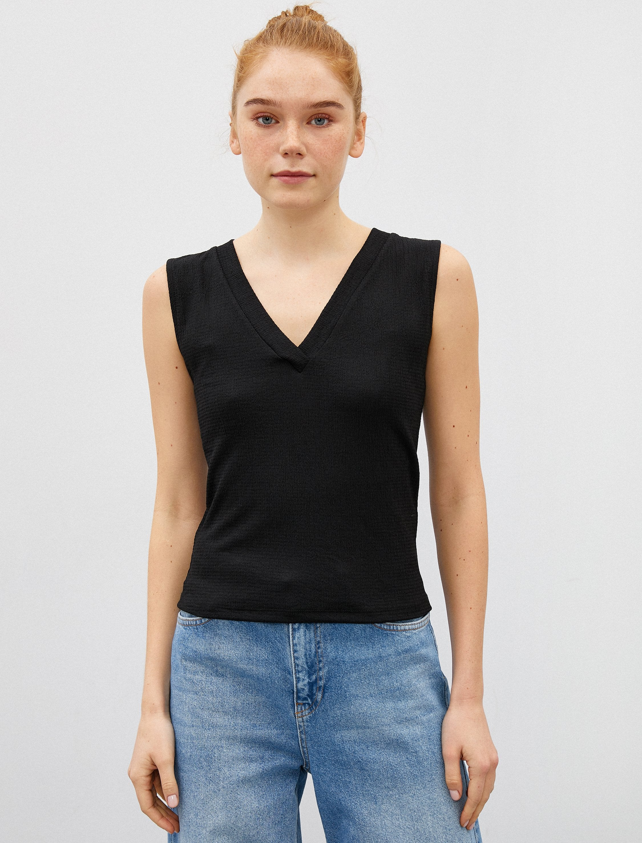 Sleeveless V-Neck Blouse in Black