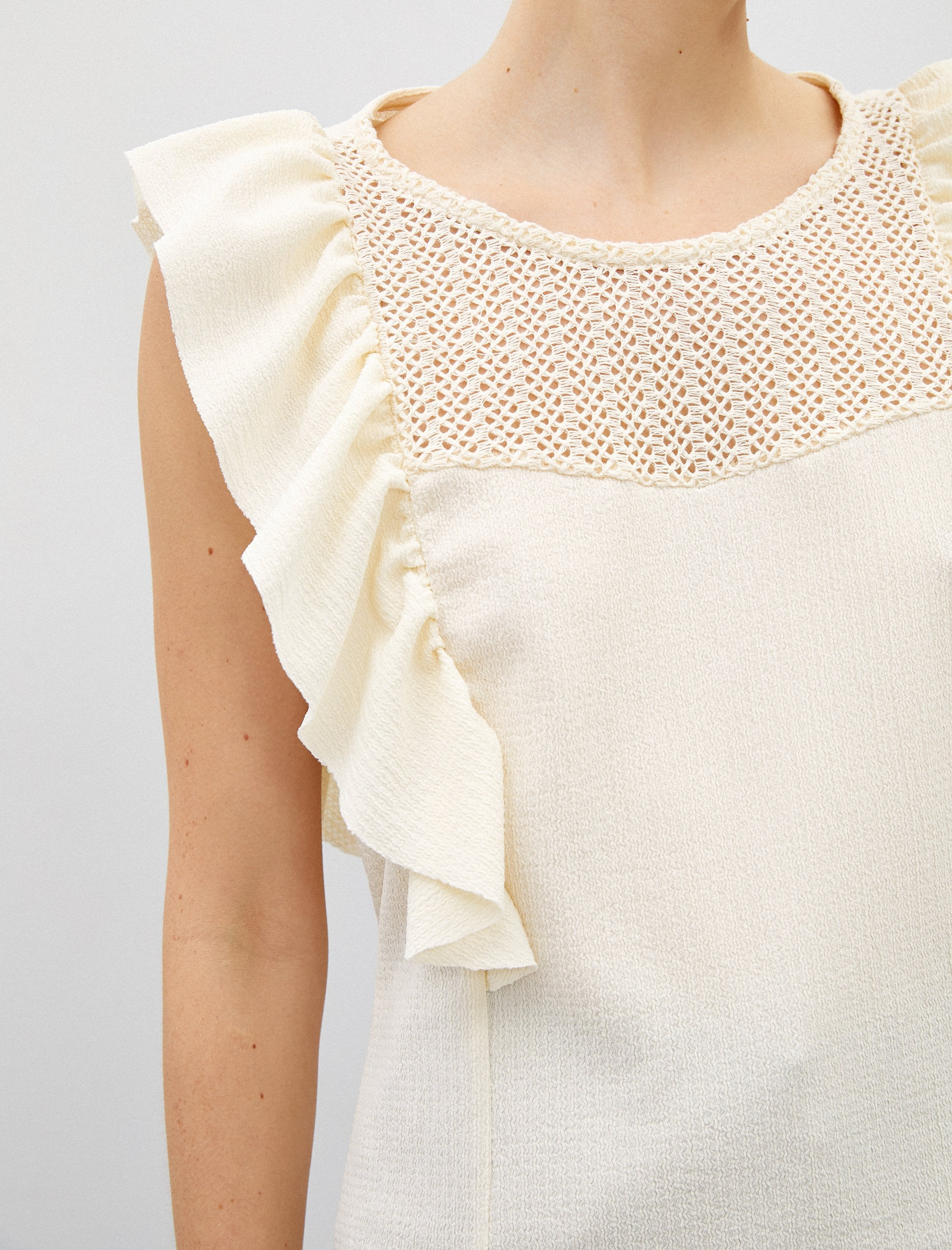 Sleeveless Ruffle Shoulder Blouse in Cream