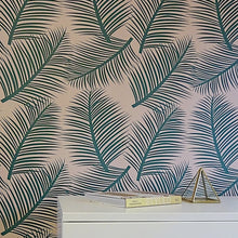 Load image into Gallery viewer, This stunning tropical green and pink wallpaper designed and printed in England in striking colours allows you to add a light and airy yet elegant element to any room in your home.