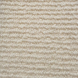 Close up texture of cheap cream wool carpet with a high and low level loop