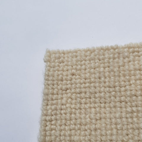 Corner of cheap Cream wool carpet featuring a sophisticated low loop pattern on display at a cheap online carpet shop based in melbourne