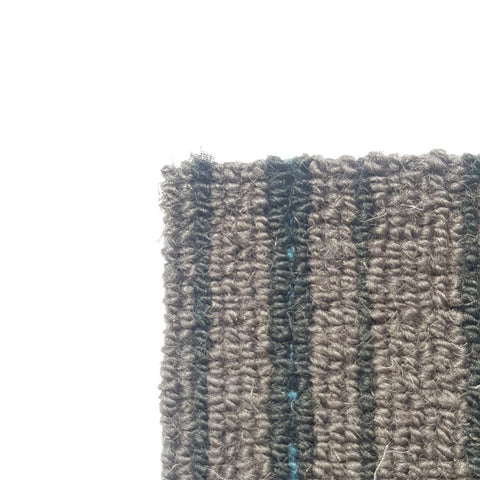 Corner of corporate style carpet with grey, blue and dark grey tones