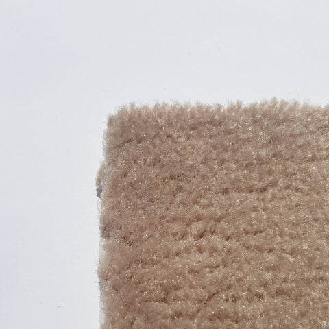 corner of a cream carpet roll that is luxuriously soft and plus made of wool in a small size on sale at cheap carpet melbourne