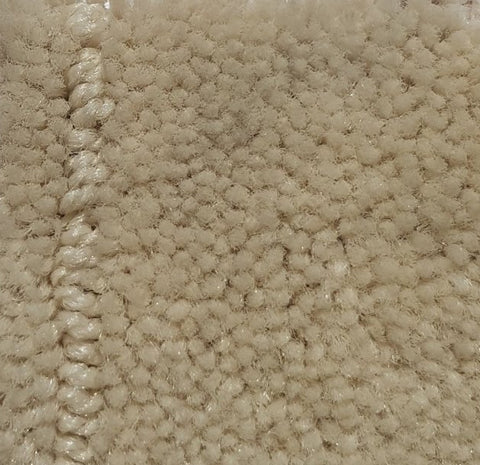 corner of a carpet roll from cheap carpet melbourne that features a Cut pile plush with small low loop outlined squares