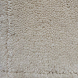 close up of cream Cut pile plush with small low loop outlined squares for sale at cheap carpet melbourne
