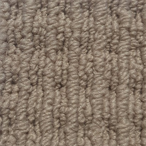 Corner of a carpet roll from cheap carpet melbourne featuring a beige nylon high low loop pattern