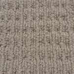 close up fibres from a carpet roll from cheap carpet melbourne featuring a beige nylon high low loop pattern
