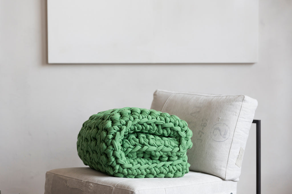 green clover weighted blanket folded on chair