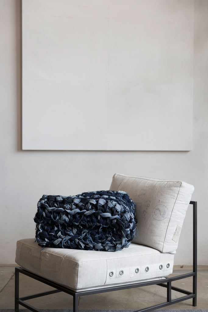 folded denim weighted blanket on chair