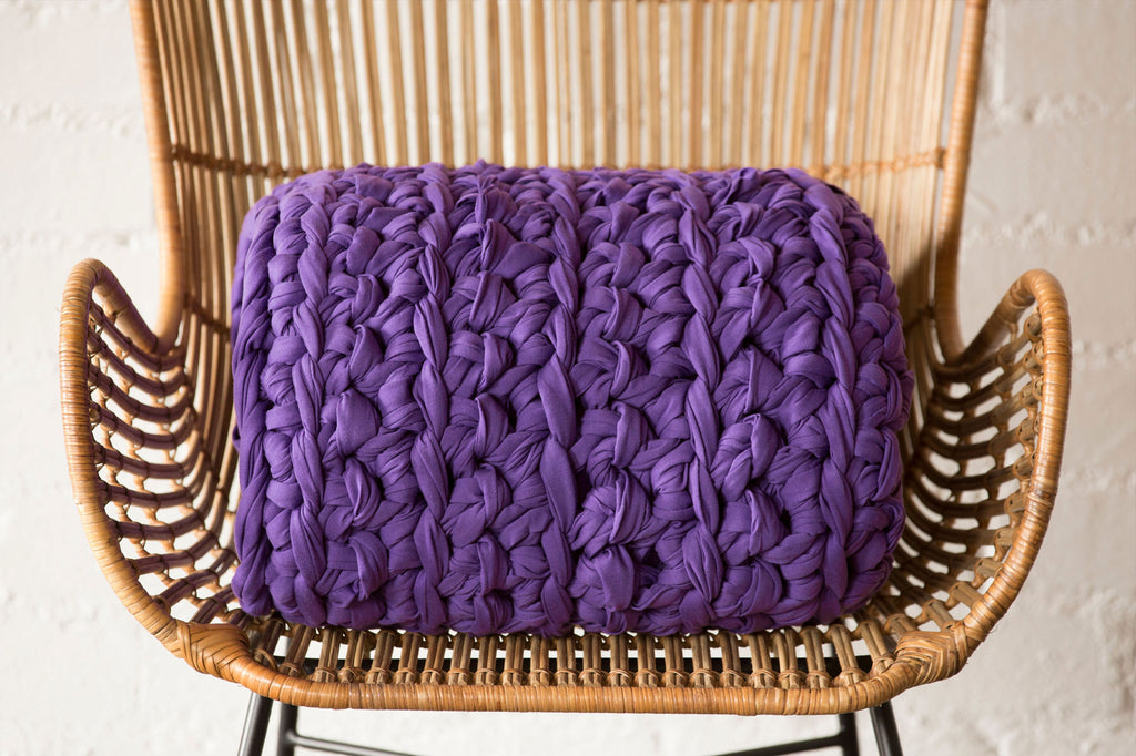 iris purple weighted blanket folded on chair
