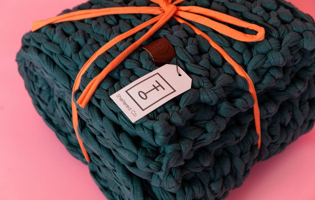 green handmade crocheted weighted blanket