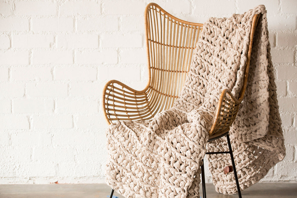 nude weighted blanket draped over chair