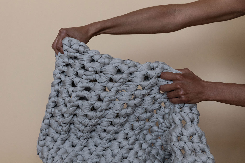 grey handmade crocheted weighted blanket