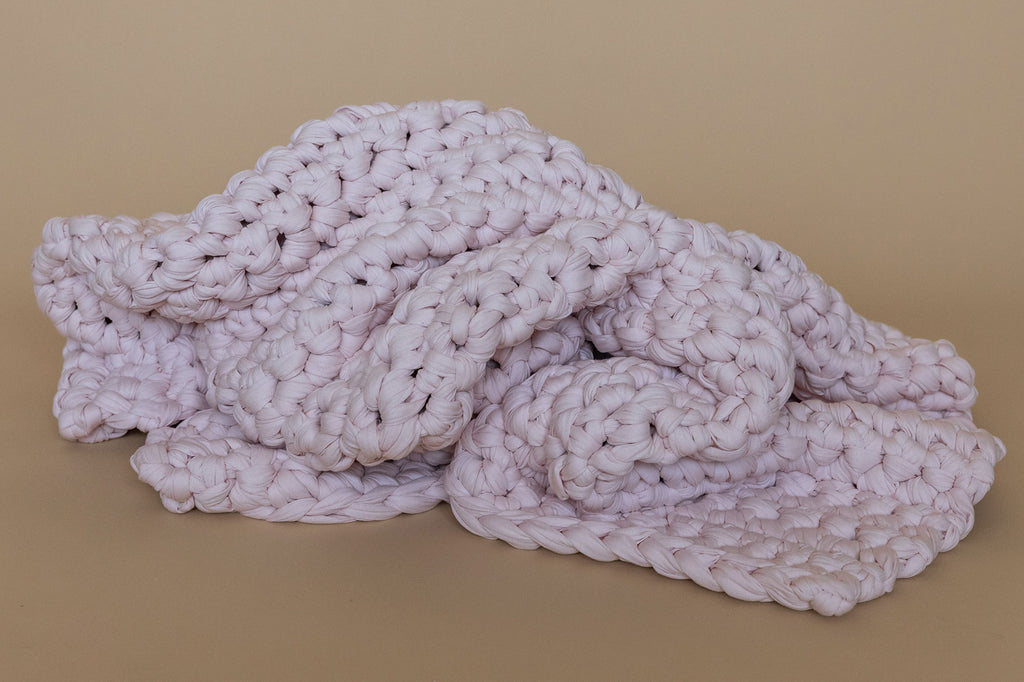 pink handmade crocheted weighted blanket