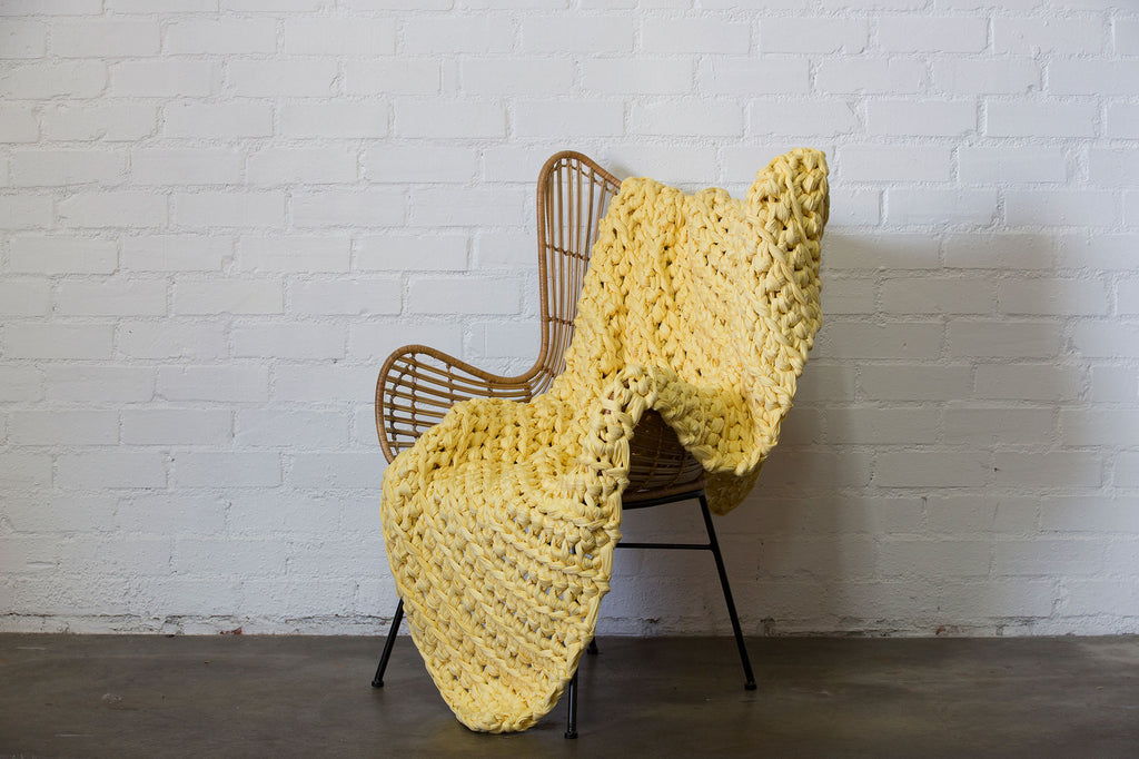 pale yellow banana taffy weighted blanket on chair