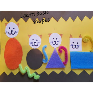 four cats made with felt shapes to represent basic shapes and their tails are made of chenille stems