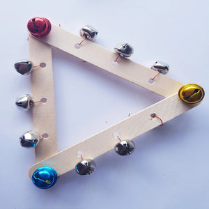 kids musical craft made with three large Popsicle sticks connected as a triangle and bells attached to each side of the triangle