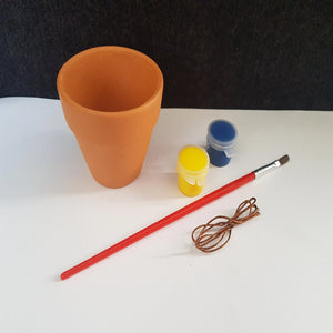 kids craft materials required for painting and decorating a small terracotta pot