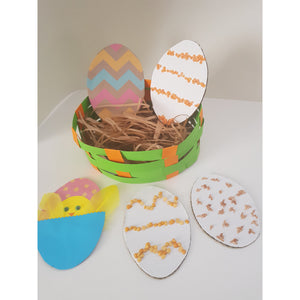 Five Easter eggs decorated with lentils, coloured rice and corn. Easter basket made with colour paper strips and cardboard base.