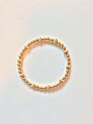 5mm 14k Gold Filled Bead Bracelet with 6mm Corrugated Accent Bead