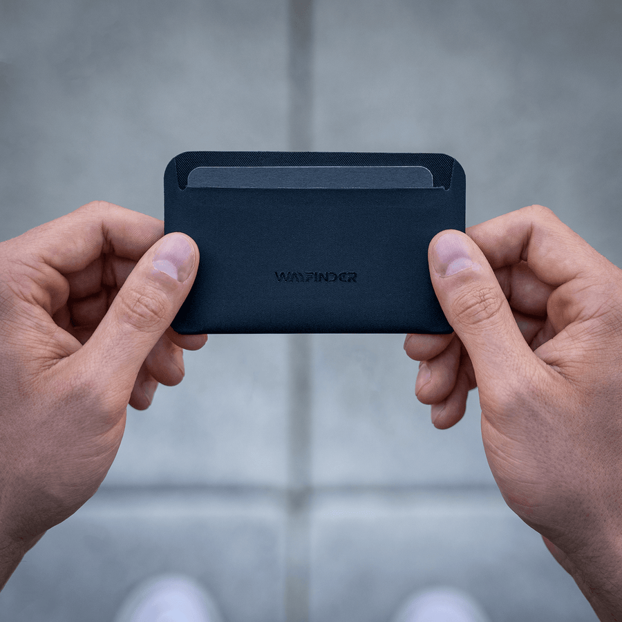 Wayfinder FLUX modern minimal cardholder top view held in hands