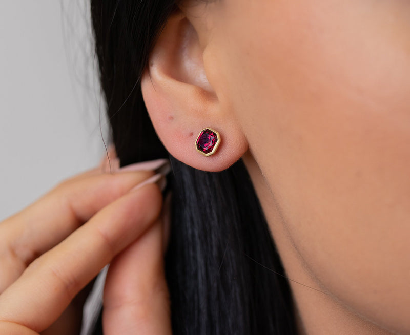 Kimberly Collins Square Faceted Rhodalite Garnet Studs on ears