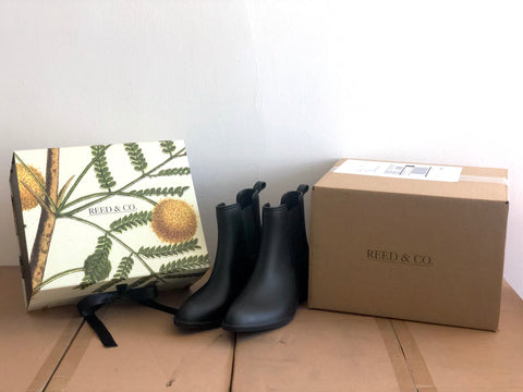 Reed & Co custom shipping box with rain boots and shoebox