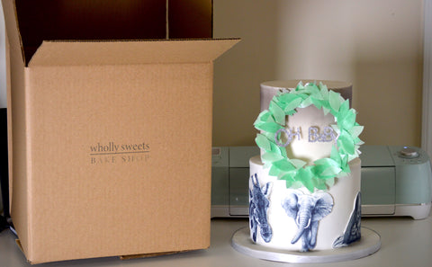 Wholly Sweets bake shop custom logo box with cake