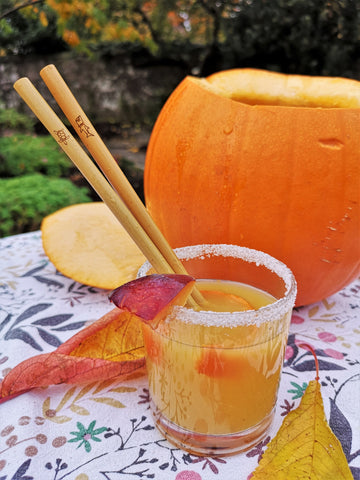 Rum punch cocktail with ocean charity straws