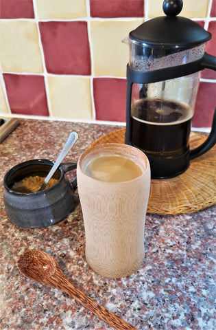 Spiced pumpkin latte in bamboo coffee cup