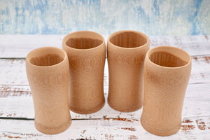 4 Bamboo cups set out in a semi circle