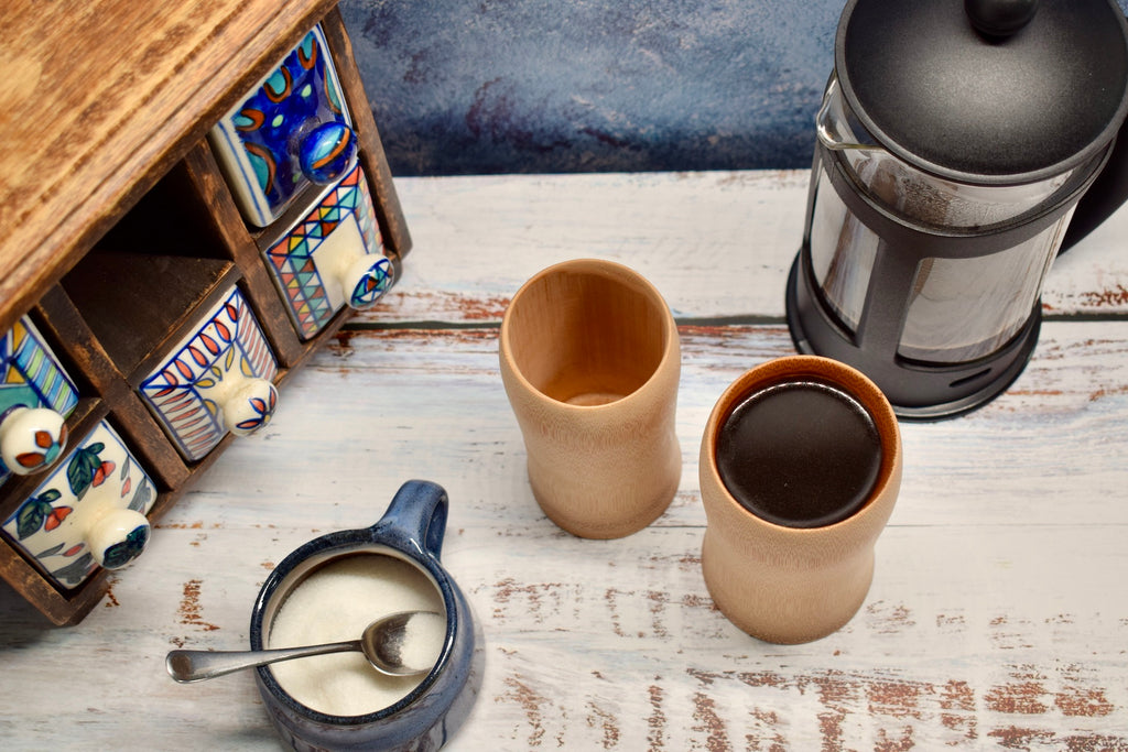Bamboo coffee cups with coffee and sugar bowl