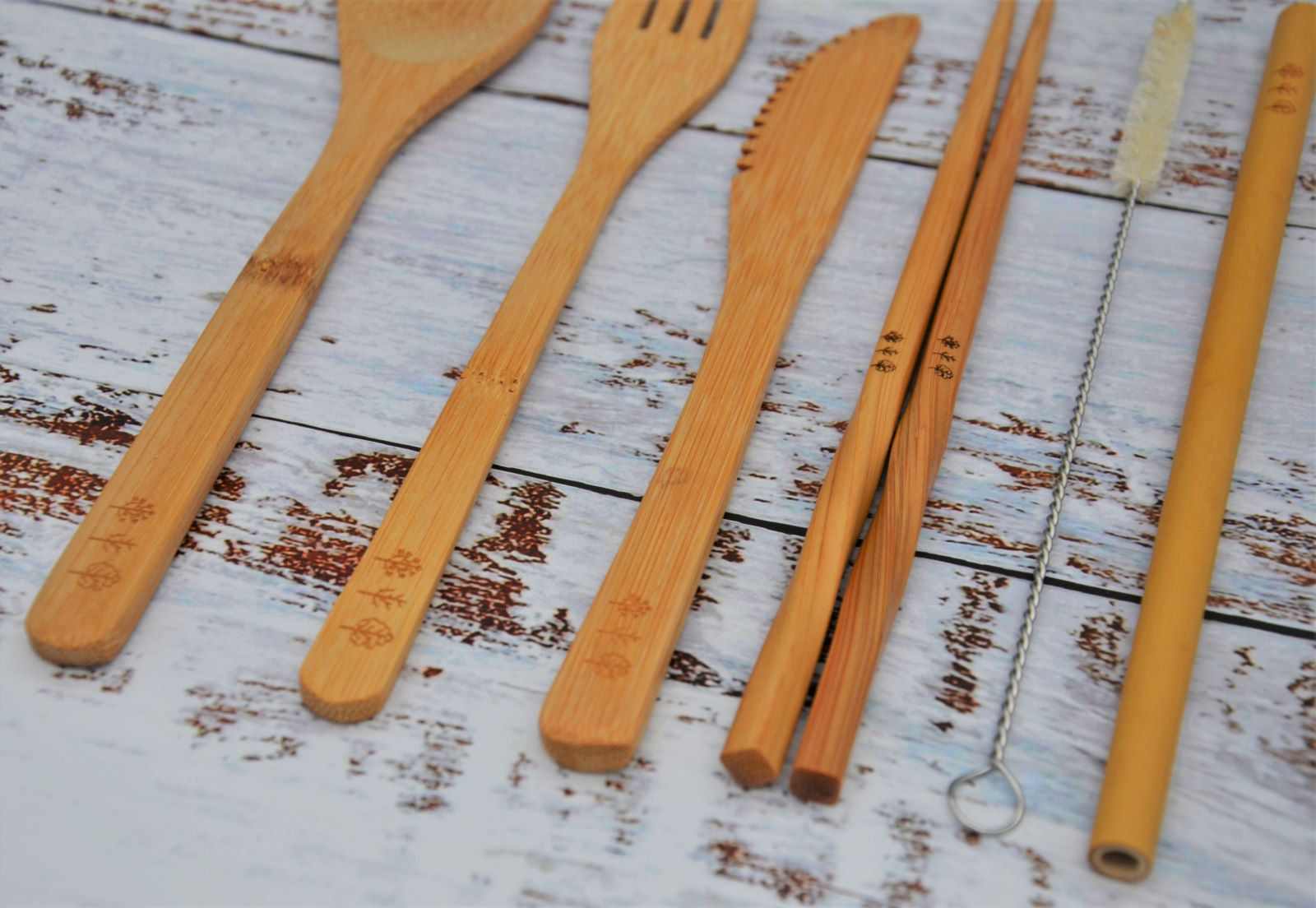 Bamboo cultery laid out, close up of logo engraved