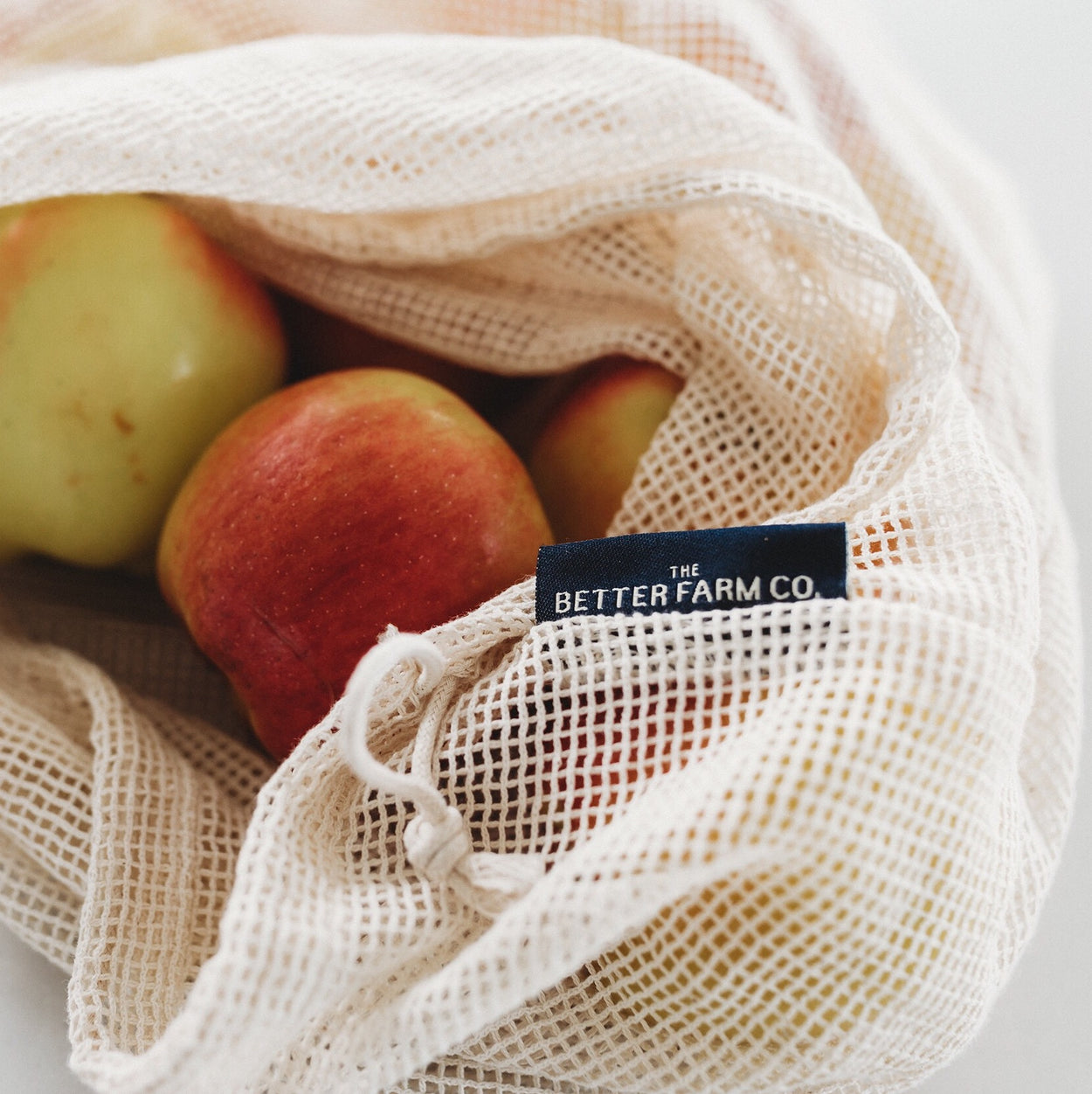 The Better Farm Co's five Mesh Produce Bags are filled with produce and bulk items, and surrounded by other sustainable, zero-waste goods. The cotton mesh produce bags are organic, and have uses beyond gathering produce at the grocery store. They are the perfect plastic-free alternative, and are versatile. You can use them for produce, lunch bags, washing bags, organizing suitcases or storing baby items in your bag.