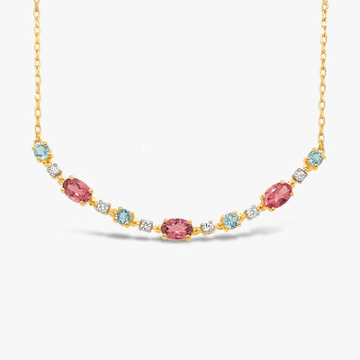 gemstone necklace with pastel pink tourmaline and pastel blue swiss blue topaz and white sapphires in different shapes. Pink tourmaline in oval shape blue topaz and white sapphire in round shape. Metal is 18k gold over silver vermeil. Chain is adjustable so can layer necklace.