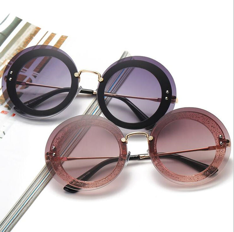 Round frameless sunglasses