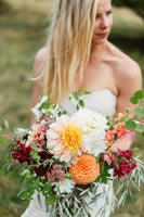 Summer dahlia bouquet by Dandelion Floral at a ranch wedding near Lander, Wyoming. photo by Lucky Malone Photography.