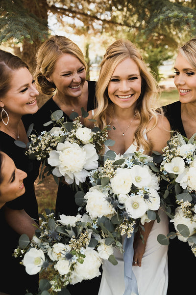 Wyoming bride and bridesmaids with bouquets
