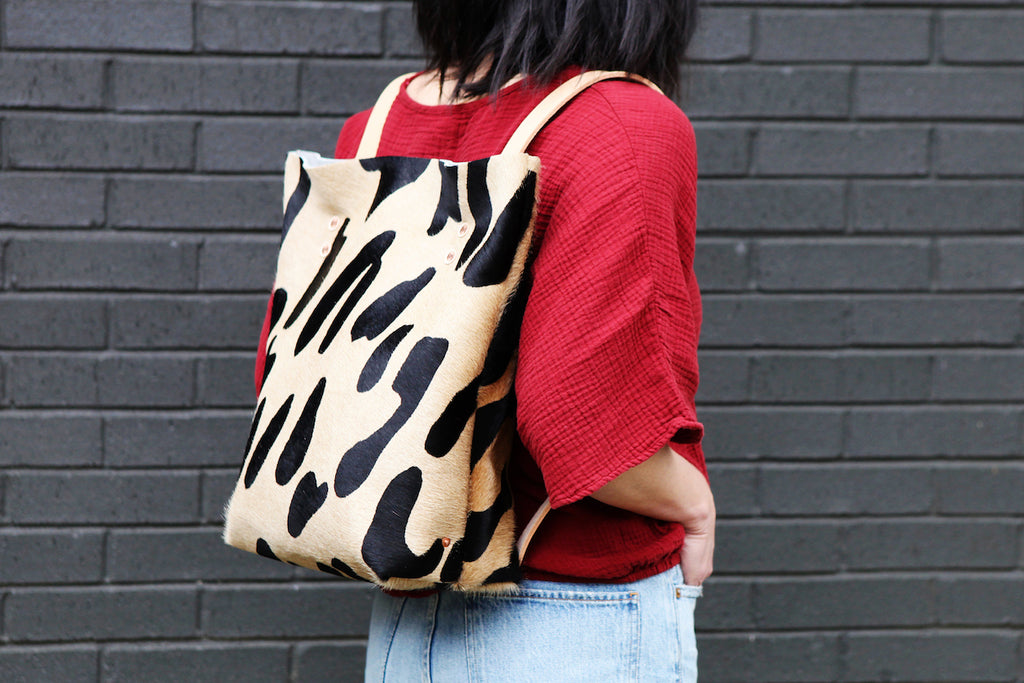 the walkabout, oversized leopard black + tan hide